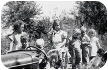the stewart children and a car