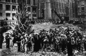 Rockefeller Center's first Christmas tree, 1931, erected by construction workers about to get paid